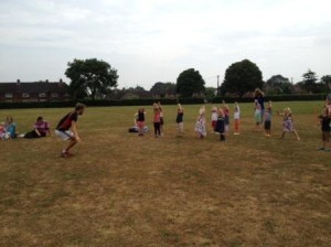 Stretching, jumping and running with Nick the Sportzcoach on The Lye Field.