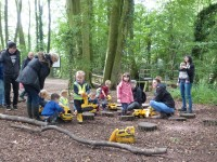 Playing on the diggers and trucks at Woodland Adventure